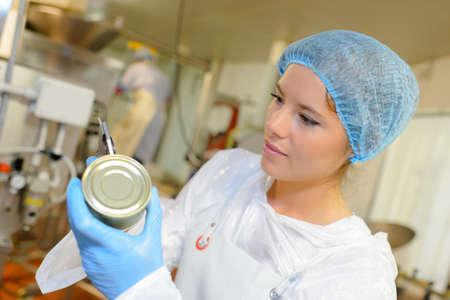 tin: woman calibrating tin goods