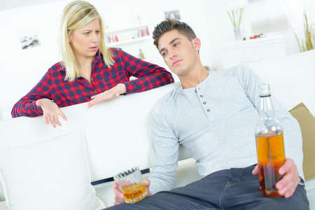 alcohols: teenager drinking on couch