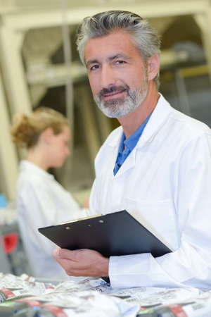 physicists: man in white coat Stock Photo