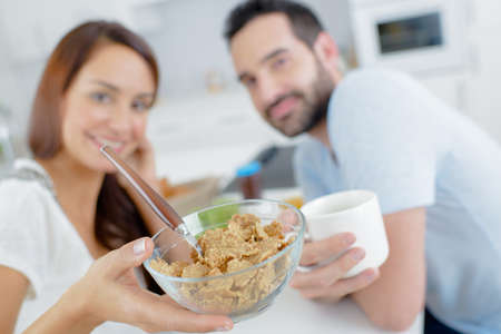 breakfast bowl: Couple having breakfast, showing bowl of cereals Stock Photo