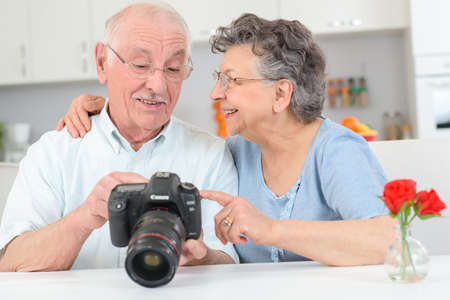 health technology: elderly couple with high powered camera