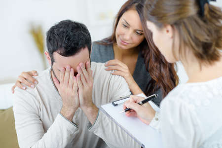 told: Man being told bad news Stock Photo