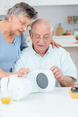 recycles: elderly couple with coffee maker
