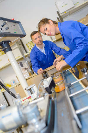 Two workers on production line Stock Photo