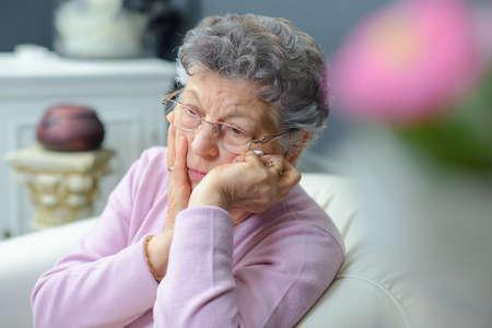 siting: sad old woman