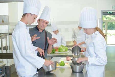 explaining: Chef explaining to trainees