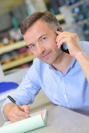 important phone call: man on the cellular phone