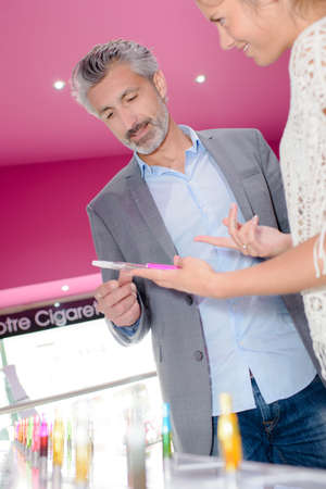 salesgirl: man at e-cigarette store Stock Photo