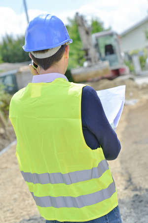 surveyor: Surveyor looking at building site Stock Photo