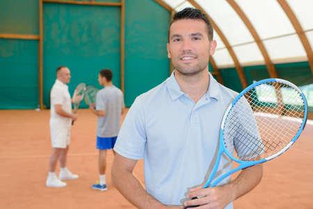 looker: men in the tennis court Stock Photo