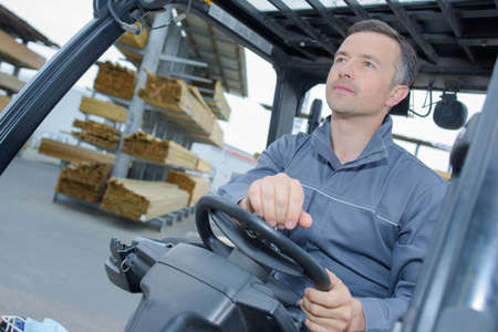 elevator operator: man driving a forklift Stock Photo