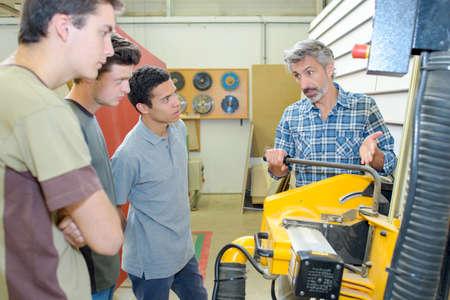 teacher showing machinery
