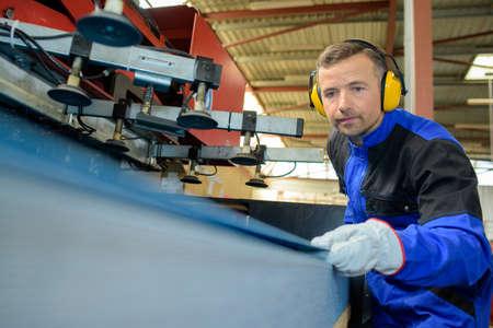 operative: Male operative using machinery