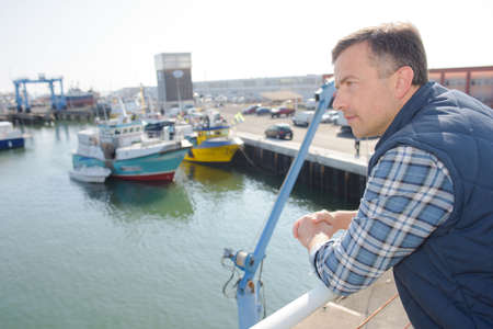 windlass: Man looking out over the harbour
