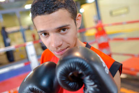 competitive sport: Portrait of young male boxer Stock Photo