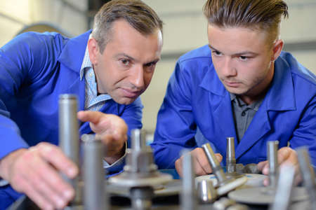 specific clothing: men in the workshop Stock Photo