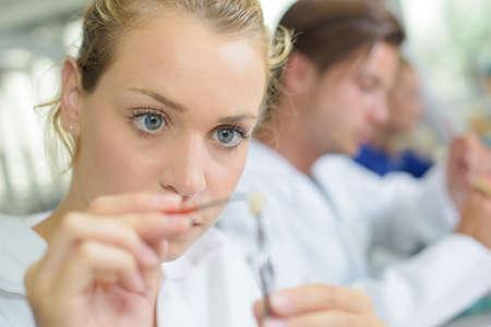 technicians: Close up of female dental technician working