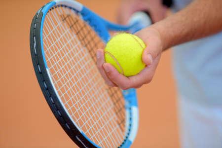 siervo: tennis ball and racket Foto de archivo