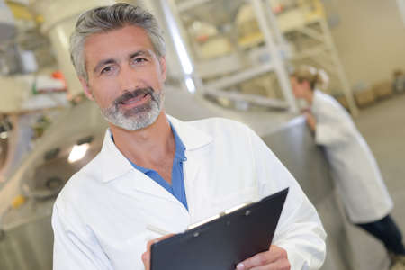 white coat: man in the factory