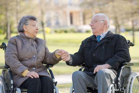 dependent: elderly couple on their wheelchair