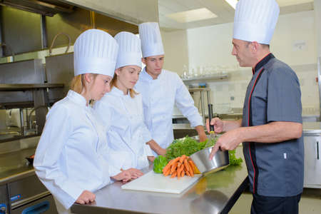whisking: Chef whisking ingredients in front of students