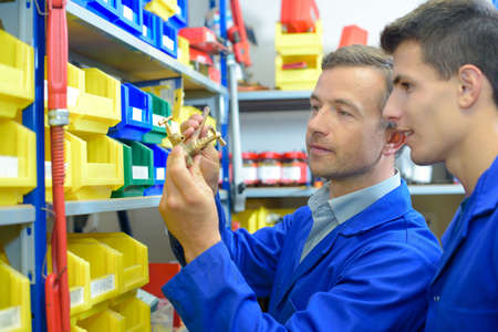 categorized: Man selecting plumbing fittings from stores