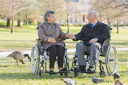senior female: elderly couple on wheelchair Stock Photo