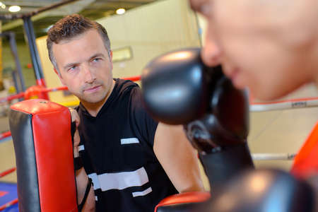 Boxing instructor with student Stock Photo