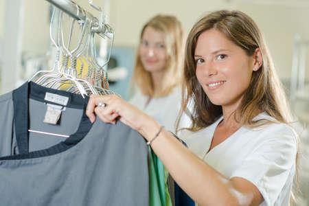 hangers: women with hangers Stock Photo
