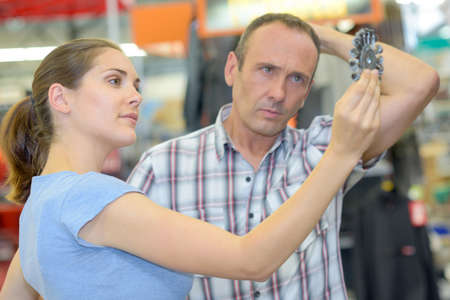 puzzlement: couple looking at drill bit