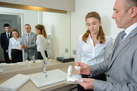 hotel staff: Hotel staff learning bathroom products