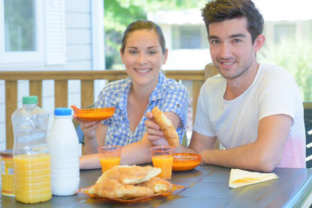 continental: Couple eating continental breakfast