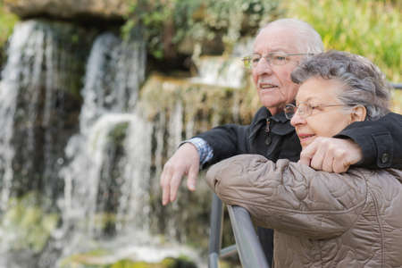 waterfall: elderly couple and a waterfalls
