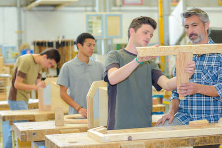 cabinetry: young men in the workshop
