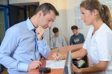 registration: Receptionist explaining to client