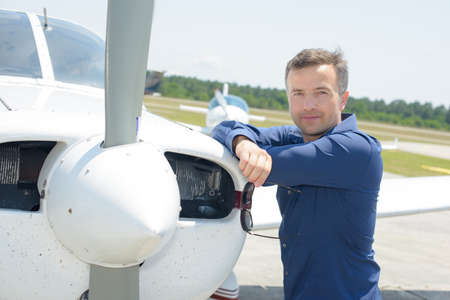 man and airplane propeller
