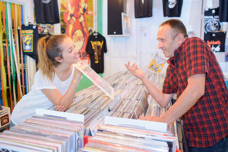 customer records: Man and lady looking at vinyl records in a shop