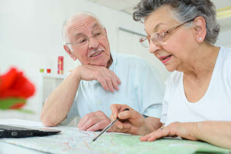 admiration: Elderly couple looking at map