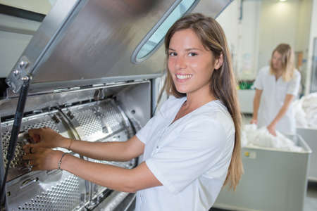Lady working in industrial laundry