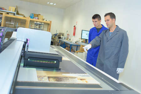 printing business: Two men in printing shop
