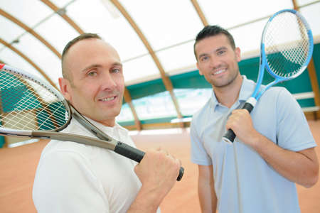 serf: two men with tennis rackets