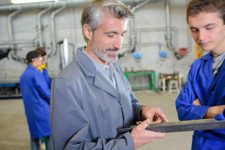 briefing: boss briefing trainee in the factory Stock Photo
