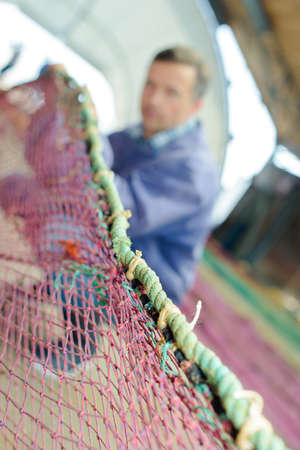 inshore: preparing the net Stock Photo