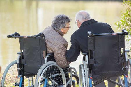 whispering: elderly couple whispering