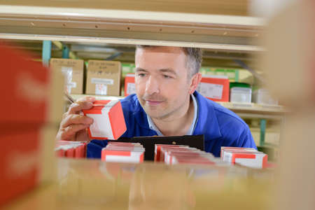 man in store room Stock Photo
