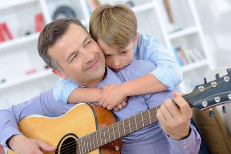 bugging: playing guitar Stock Photo