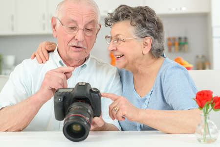 high powered: looking at the pictures Stock Photo