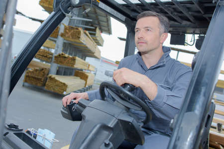experienced operator: Man driving a forklift Stock Photo