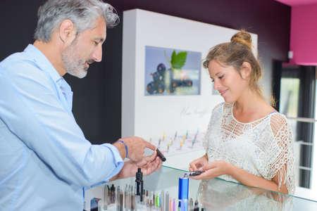 salesgirl: e-cigarette store Stock Photo