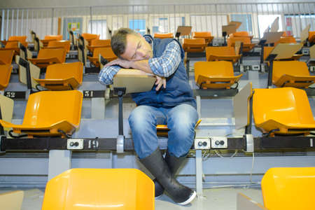 wellingtons: Man in wellingtons asleep on desk